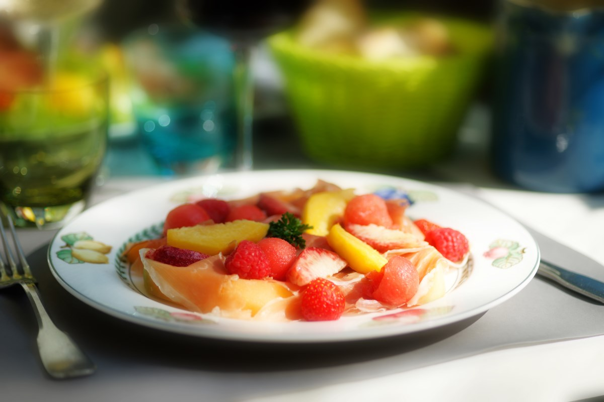 Zoom on a season fresh fruit dish with ham of Savoy